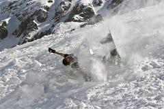 De neerstorting van Snowboarding Stock Afbeeldingen
