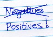 De negatieven van de schrapping en het schrijven positieven. Stock Foto