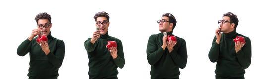 De nerd jonge die man met piggybank op wit wordt geïsoleerd stock fotografie