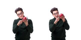 De nerd jonge die man met piggybank op wit wordt geïsoleerd royalty-vrije stock afbeeldingen