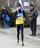 De niet geïdentificeerde mensen bij de 20.000 meters ras lopen Stock Foto's