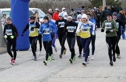 De niet geïdentificeerde vrouwen bij de 20.000 meters ras lopen Royalty-vrije Stock Afbeeldingen