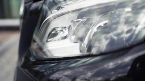 De nieuwe autokoplampen zijn mooi voorraad Dure autokoplamp stock videobeelden