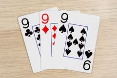 3 de nines buenos 9 - casino que juega tarjetas del póker foto de archivo libre de regalías