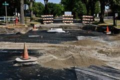 De niveauszand van wegnivelleermachines in een wegenbouwproject stock afbeeldingen