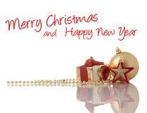 Or de Noël et décorations rouges Photos libres de droits