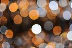 Or de Noël et de nouvelle année et fond blanc de lumières de bokeh photos libres de droits