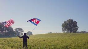 De Noord- van Korea vlag van Amerika en stock videobeelden