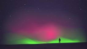 De nordliga ljusen med en man i förgrunden Arkivbild