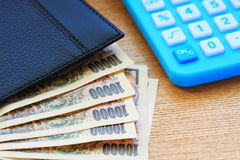De nota en de calculator van de munt royalty-vrije stock afbeelding