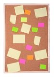 De Nota's van de post-it over een Cork Raad stock afbeelding