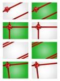 De notakaarten van de vakantie met rode giftbogen en linten Stock Fotografie