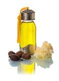 De noten van de sheaboom met oill en boter stock afbeelding