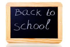 De nouveau à l'école écrite sur l'ardoise de tableau noir Photo stock