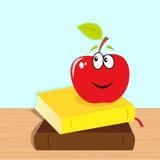 De nouveau à l'école : livres et pomme de sourire rouge Image stock