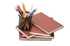 De nouveau au concept d'école avec des livres et des crayons Photographie stock libre de droits