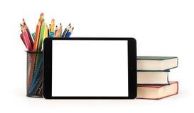 De nouveau au concept d'école Comprimé, crayons et livres de Digital Photos stock