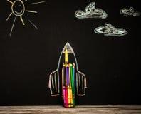 De nuevo al cohete de la escuela fuera de los lápices Imágenes de archivo libres de regalías