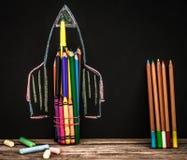 De nuevo al cohete de la escuela fuera de los lápices Fotos de archivo libres de regalías