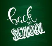 De nuevo al ejemplo del vector de las letras de la escuela De nuevo a caligrafía de la escuela en fondo de la pizarra Foto de archivo