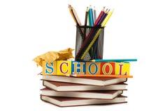 De nuevo a concepto de la escuela con los libros y los lápices Imagen de archivo libre de regalías