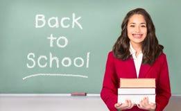 De nuevo a escuela Adolescente bastante étnico o hispánico delante de tiza Imagen de archivo libre de regalías