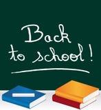 ¡De nuevo a escuela! marcado con tiza en la pizarra Imágenes de archivo libres de regalías