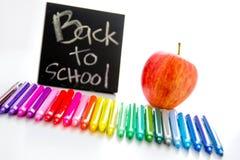 De nuevo a fuentes de escuela y a una manzana para el profesor Imagen de archivo