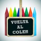 De nuevo a la escuela escrita en español: col del al del vuelta Imágenes de archivo libres de regalías