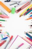 De nuevo a las herramientas de la escuela o de la oficina en el fondo blanco Fotografía de archivo libre de regalías