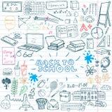 De nuevo a los garabatos incompletos del cuaderno de las fuentes de escuela fijados con las letras, elementos a mano del diseño d Imagen de archivo libre de regalías