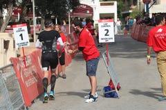 De oefeningssport van het Triathletetriatlon het gezonde lopen Stock Foto
