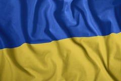 De Oekraïense vlag vliegt in de wind Kleurrijke, nationale vlag van de Oekraïne Patriottisme, een patriottisch symbool stock illustratie