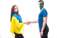De Oekraïne versus handdruk de Noord- van Ierland vóór spel op witte achtergrond Royalty-vrije Stock Afbeeldingen