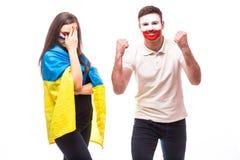 De Oekraïne versus Polen op witte achtergrond De voetbalventilators van nationale teams tonen emoties aan Royalty-vrije Stock Foto