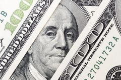 De ogen van Benjamin Franklin ` s van een honderd-dollar rekening Het gezicht van Benjamin Franklin op het honderd dollarsbankbil royalty-vrije stock foto