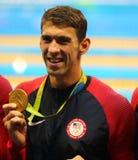 De olympische kampioen Michael Phelps van de V.S. viert overwinning bij het de hutspotrelais van Mensen 4x100m van Rio 2016 Olymp Stock Foto's