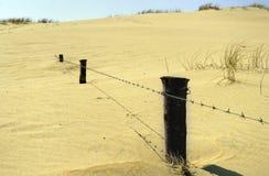 De omheining van het zand stock afbeelding