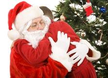 De Omhelzing van Kerstmis van de kerstman Stock Afbeeldingen