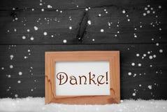 De omlijsting met Danke-Middelen dankt u, Sneeuw, Sneeuwvlokken Stock Afbeeldingen