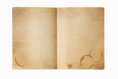 De omslag van Grungemanilla met koffievlekken, op wit worden geïsoleerd dat Royalty-vrije Stock Afbeelding