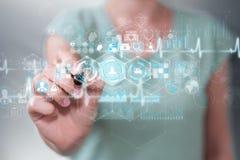 De onderneemster die digitale medische interface met een 3D pen gebruiken trekt uit Stock Fotografie