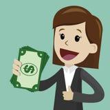 De onderneemster houdt geld in zijn hand en heeft winst Succsessfulzaken betalingen Stock Fotografie