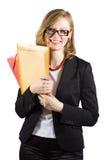 De onderneemster van Smiley met gekleurde omslagen Stock Afbeelding