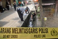 DE ONDERZOEKER VAN DE DE MISDAADscène VAN INDONESIË Stock Foto's