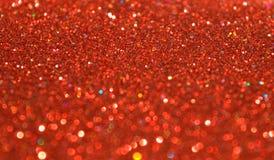 De onscherpe achtergrond van rood schittert fonkelingen Stock Fotografie