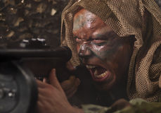 De oorlogsschreeuw van de guerilla. Royalty-vrije Stock Foto's