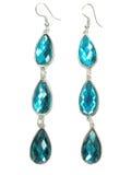 De oorringen van juwelen met blauwe kristallen Stock Foto's