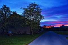 De Oostenrijkse dageraad van de de bergweg van landbouwbedrijfalpen Royalty-vrije Stock Fotografie