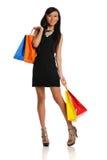 De oosterse vrouw van Yound met het winkelen zakken Stock Foto's